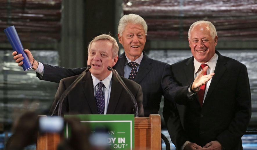 Former President Bill Clinton appears with U.S. Senator Dick Durbin, left, and Illinois Gov. Pat Quinn as they address workers, labor leaders and business leaders at Wheatland Tube Co., Tuesday, Oct. 21, 2014, in Chicago. Clinton is the latest Democratic heavyweight to drop into Illinois to stump for Gov. Pat Quinn in his battle against GOP businessman Bruce Rauner. (AP Photo/M. Spencer Green)