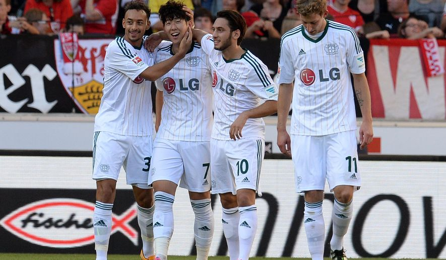 From left: Leverkusen's Stefan Reinartz, Son Heung-min,, Hakan Calhanoglu  and Stefan Kiessling celebrate a goal during the German first division Bundesliga soccer match between VfB Stuttgart and Bayer Leverkusen in Stuttgart, southern Germany, Saturday Oct. 18, 2014.  (AP Photo/dpa, Bernd Weissbrod)