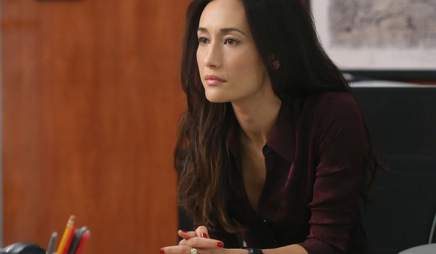 "In this image released by CBS, Maggie Q appears in a scene from ""Stalker."" The series, which stars Maggie and Dylan McDermott as detectives who investigate stalking incidents for the Threat Assessment Unit of the LAPD, airs Wednesdays at 10 p.m. ET. (AP Photo/CBS, Monty Brinton)"