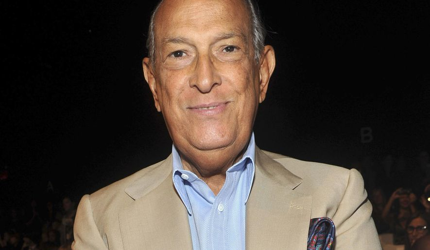 FILE - In this Sept. 11, 2011 file photo, designer Oscar de la Renta attends the Diane von Furstenberg Spring 2012 fashion show during Fashion Week in New York. De la Renta received the 2012 Couture Council Award by The Fashion Institute of Technology in New York. De la Renta, a favorite of socialites and movie stars alike, has died. He was 82. (AP Photo/Diane Bondareff, File)