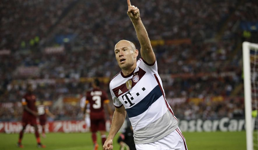 Bayern's Arjen Robben celebrates after scoring his sides fourth goal during the Group E Champions League soccer match between Roma and Bayern Munich at the Olympic stadium, in Rome, Tuesday, Oct. 21, 2014. (AP Photo/Andrew Medichini)