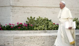 "In his address to synod participants, Pope Francis said the church has one year ""to mature, with true spiritual discernment, the proposed ideas and to find concrete solutions to so many difficulties and innumerable challenges that families must confront."" (AP Photo/Andrew Medichini)"