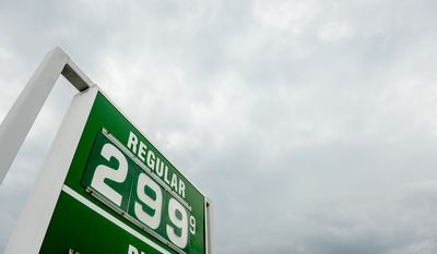 regular gas sells for less then three dollars a gallon at a Hess in Clarendon, Arlington, VA., Tuesday, October 21, 2014. (Andrew Harnik/The Washington Times)
