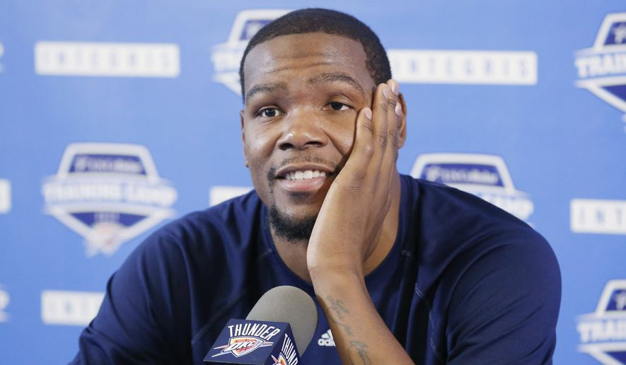 Oklahoma City Thunder forward Kevin Durant answers questions at a news conference in Oklahoma City, Tuesday, Oct. 21, 2014. Durant said he's been antsy since finding out he will miss the early part of the season with a Jones fracture in his right foot. The reigning NBA MVP spoke to the media Tuesday morning for the first time since the injury. (AP Photo/Sue Ogrocki)