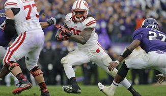 Wisconsin running back Melvin Gordon (25) runs with the ball against Northwestern during the second half of an NCAA college football game in Evanston, Ill., Saturday, Oct. 4, 2014. Northwestern won 20-14. (AP Photo/Nam Y. Huh)