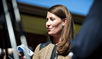 Alison Lundergan Grimes speaks to reporters, Wednesday, Oct. 22, 2014, after her appearance at the Bowling Green Noon Rotary Club in Bowling Green, Kentucky. (AP Photo/Daily News, Miranda Pederson)