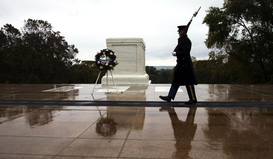 Tomb guards walks at the Tomb of the Unknown Soldier in Arlington National Cemetery in Arlington, Va., Wednesday, Oct. 22, 2014. (AP Photo/Manuel Balce Ceneta)  ** FILE **