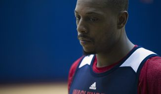 In this Oct. 16, 2014, photo, Washington Wizards NBA basketball player Paul Pierce participates in team practice at the Verizon Center in Washington. One move changed everything for Pierce last season. (AP Photo/Cliff Owen)