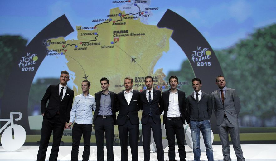 From left Marcel Kittel of Germany, Blel Kadri of France, Tony Gallopin of France, Alexander Kristoff of Norway, Vicenzo Nibali of Italy, Thibaut Pinot of France, Jean-Christophe Peraud of France and Cadel Evans of Australia pose during the presentation of the Tour de France 2015 cycling race, in Paris, Wednesday, Oct. 22, 2014.  Starting in Utrecht, Netherlands, on July 4 2015, the 102th Tour ends 22 days later, as is traditional, on the Champs-Elysees in Paris. (AP Photo/Christophe Ena)