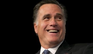 Former Massachusetts governor and Republican presidential nominee Mitt Romney laughs while speaking to members of the business community at the Boise Centre in Boise, Idaho, on Oct. 22, 2014. (Associated Press/The Idaho Statesman, Kyle Green) **FILE**
