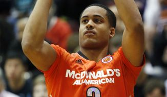 **FILE** McDonald's East All-American Melo Trimble, of Upper Marlboro, Md., competes in the three-point shootout during the McDonald's All-American Jam Fest at the University of Chicago in Chicago, on Monday, March 31, 2014. (AP Photo/Andrew A. Nelles)