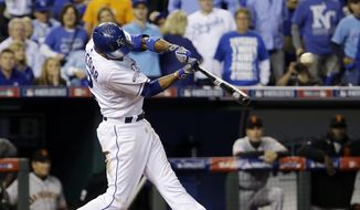 Kansas City Royals' Alcides Escobar hits an RBI double during the second inning of Game 2 of baseball's World Series against the San Francisco Giants Wednesday, Oct. 22, 2014, in Kansas City, Mo. (AP Photo/David J. Phillip)