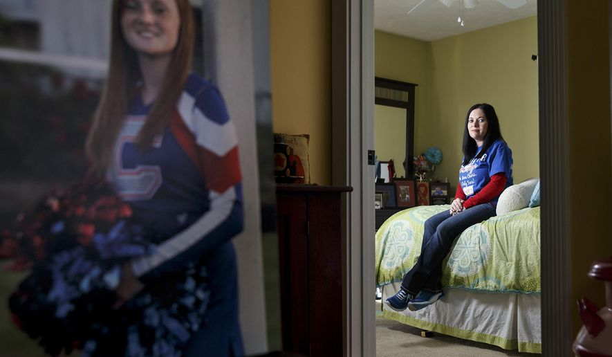 ADVANCE FOR USE SATURDAY, OCT. 26 AND THEREAFTER - In this Sept.  27, 2014 photo, Kristy Armstrong-Ott, right, sits in her home in Carlinville, Ill. with a photo of her late daughter Brooklyn Armstrong in the foreground. In memory of her daughter, Armstrong-Ott and her husband launched a local campaign for seat belt awareness with plans to take it statewide. Brooklyn Armstrong, 16, was killed in a crash in December when she was thrown from a pickup truck. She was not wearing a seat belt.  (AP Photo/The State Journal-Register,Ted Schurter)
