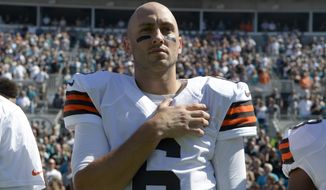 Cleveland Browns quarterback Brian Hoyer (6) stands for the singing of the national anthem before an NFL football game against the Jacksonville Jaguars in Jacksonville, Fla., Sunday, Oct. 19, 2014.(AP Photo/Phelan M. Ebenhack)