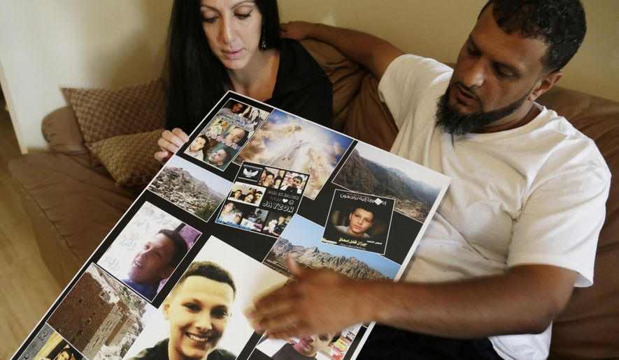 Amanda Mosed, 33, of Dearborn Heights and her ex-husband Fadhl Mosed, 38, of Detroit  looks at photos of  their 13-year-old son Jayzon in Detroit on Monday, Oct. 6, 2014.  Jayzon Mosed died Sept. 19 in Yemen after being shot in the head Aug. 6 in what was described as a feud between two families.  Jayzon, the second-oldest of seven siblings, had made the trip to his father's homeland this summer before he was to start eighth grade at Priest Elementary-Middle School in Detroit.  (AP Photo/Detroit Free Press, Mandi Wright)  DETROIT NEWS OUT;  NO SALES