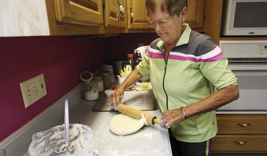 ADVANCE FOR USE SATURDAY, OCT. 25 AND THEREAFTER - In this Sept. 24, 2014 photo, Marilyn Stout makes yeast sweet rolls at her home in Camp Point, Ill. Stout cooks mostly from scratch for family, friends and community events. (AP Photo/The Quincy Herald-Whig, Steve Bohnstedt)