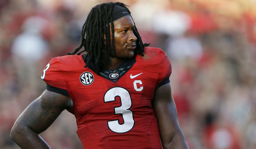 FILE - In this Sept. 7, 2013, file photo, Georgia running back Todd Gurley is shown in an NCAA college football game against South Carolina in Athens, Ga. Gurley has been suspended indefinitely while the school investigates an alleged violation of NCAA rules, the school announced Thursday, Oct. 9, 2014. (AP Photo/John Bazemore, File)