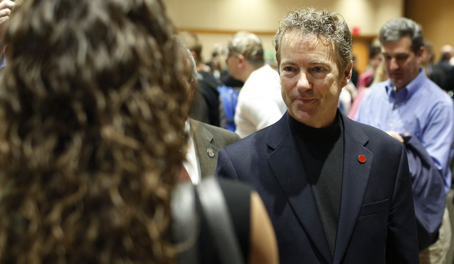 U.S. Sen. Rand Paul, R-Ky., meets with students and faculty after speaking at a campaign event for Republican businessman Rod Blum, who is running against Democratic state lawmaker Pat Murphy in the 1st Congressional District, Wednesday, Oct. 22, 2014, on the University of Northern Iowa campus in Cedar Falls, Iowa. (AP Photo/Waterloo Courier, Matthew Putney)