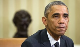 President Barack Obama pauses as he speaks to the media about the government's Ebola response in the Oval Office of the White House, Wednesday, Oct. 22, 2014, in Washington. (AP Photo/Jacquelyn Martin)