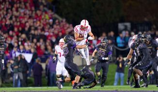 Nebraska receiver Jordan Westerkamp (1) leaps over Northwestern defender Godwin Igwebuike (16) with 12:37 left in the second quarter. The Nebraska Cornhuskers played a football game against the Northwestern Wildcats at Ryan Field in Evanston, Illinois, Oct. 18, 2014. (AP Photo/The World-Herald, Matt Miller)