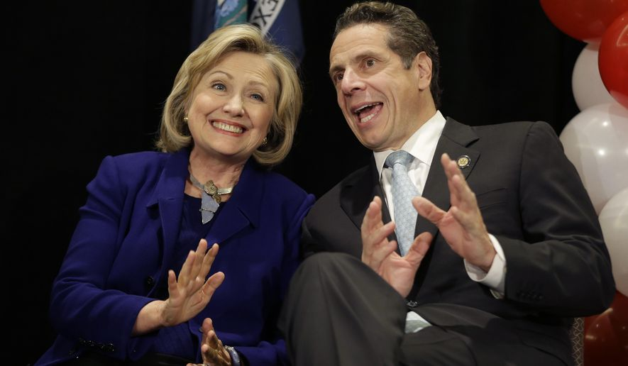 "Former Secretary of State Hillary Rodham Clinton and New York Governor Andrew Cuomo sit together on the stage during a ""Women for Cuomo"" campaign event in New York, Thursday, Oct. 23, 2014.  Mrs Clinton is backing Cuomo in his bid for a second term.  Cuomo faces Republican Westchester County Executive Rob Astorino in the Nov. 4 general election. (AP Photo/Seth Wenig)"
