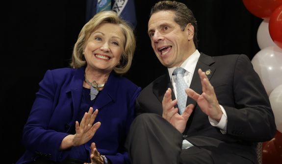 """Former Secretary of State Hillary Rodham Clinton and New York Governor Andrew Cuomo sit together on the stage during a """"Women for Cuomo"""" campaign event in New York, Thursday, Oct. 23, 2014.  Mrs Clinton is backing Cuomo in his bid for a second term.  Cuomo faces Republican Westchester County Executive Rob Astorino in the Nov. 4 general election. (AP Photo/Seth Wenig)"""