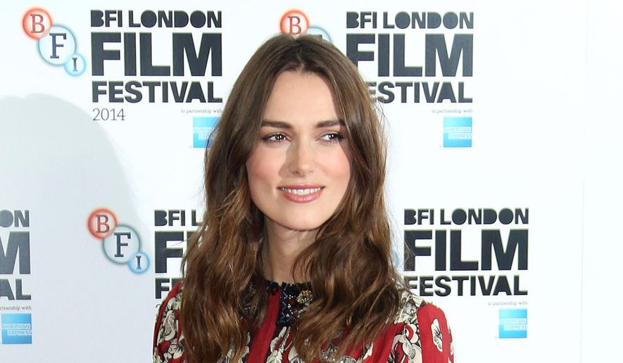 """In this Oct. 8, 2014, file photo, British actress Keira Knightley poses during the photo call of the film """"The Imitation Game"""", at the Corinthia Hotel in central London. (Photo by Joel Ryan/Invision/AP, File)"""