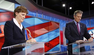 U.S. Sen. Jeanne Shaheen, D-N.H., left, and former Massachusetts Republican U.S. Sen. Scott Brown prepsre Thursday Oct. 23, 2014 before a live televised U.S. Senate debate hosted by NH1 News on WBIN TV in Concord, N.H. (AP Photo/Jim Cole)