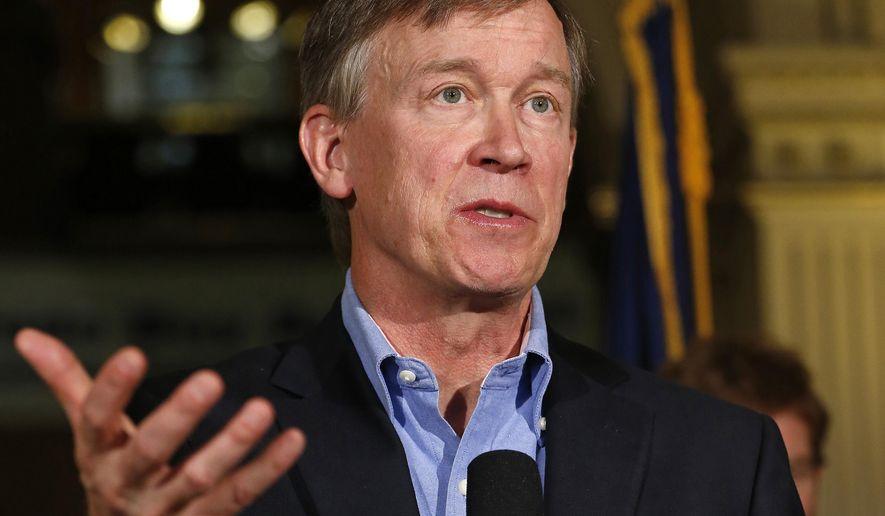 Colorado Gov. John Hickenlooper speaks at the Capitol in Denver on Aug. 4, 2014. (Associated Press) ** FILE **