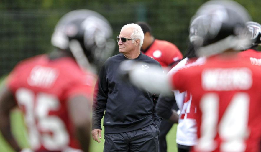 In this photo provided by the NFL, Atlanta Falcons head coach Mike Smith attends a team football practice session at London Colney, on the outskirts of London, Thursday, Oct. 23, 2014. The Atlanta Falcons will play the Detroit Lions in an NFL football game at London's Wembley Stadium on Sunday. (AP Photo/NFL, Sean Ryan)