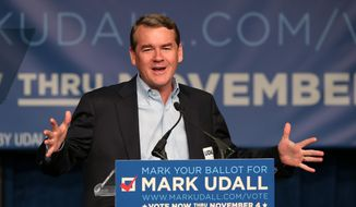 Sen. Michael Bennet, Colorado Democrate, addresses supporters before first lady Michelle Obama speaks during rally for re-election of Sen. Mark Udall in Denver on Oct. 23, 2014. (Associated Press) **FILE**