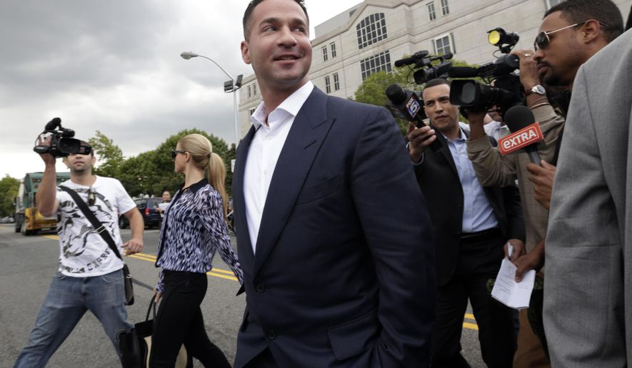 "FILE - In this Wednesday, Sept. 24, 2014, file photo, Mike ""The Situation"" Sorrentino leaves the Martin Luther King Jr. Federal Building & Courthouse, in Newark, N.J., after a court appearance. Sorrentino and his brother Marc face an arraignment Thursday, Oct. 23, 2014, in Newark, to face federal tax charges. (AP Photo/Julio Cortez, File)"