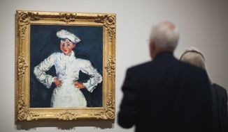 "In this Oct. 22, 2014 photo, Chaim Soutine's painting ""The Little Pastry Chef"" hangs on display during a preview of the High Museum's new exhibit, ""Cezanne and the Modern: Masterpieces of European Art from the Pearlman Collection,"" in Atlanta. (AP Photo/David Goldman)"