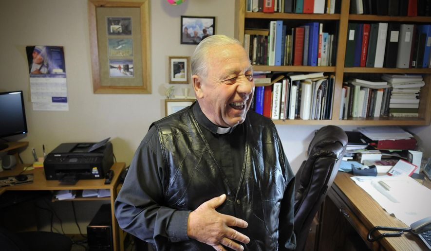 FOR RELEASE MONDAY, OCTOBER 27, 2014, AT 12:01 A.M. CDT.- Father Julius Beckerman shares a laugh in his office at the Jacob's Prairie, Minn., parish house near Cold Spring, Minn., Wednesday, Oct. 1. (AP Photo/The St. Cloud Times, Dave Schwarz)