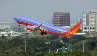 In this May 15, 2014 photo, a Southwest Airlines Boeing 737-700 takes off from Tampa International Airport in Tampa, Fla. Southwest Airlines reports quarterly financial results on Thursday, Oct. 23, 2014. (AP Photo/Chris O'Meara)