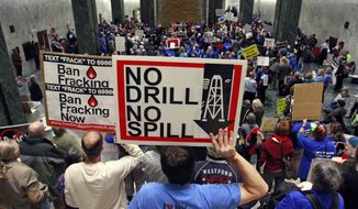 Despite protests from environmentalists, a Senate report has touted the safety of fracking. (AP Photo/Mike Groll, File)