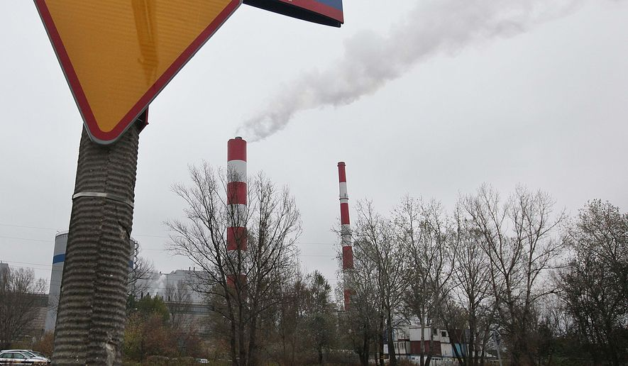 Smoke rises from a heat and power plant in Warsaw, Poland, Thursday, Oct. 23, 2014. European Union leaders meeting in Brussels to stamp their new, ambitious greenhouse gas emissions plan should prepare for unyielding opposition from coal-reliant Poland and some other East European countries who say their developing economies and electricity bills would suffer too much from the new target. (AP Photo/Czarek Sokolowski)