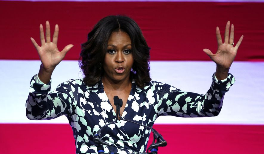 First lady Michelle Obama campaigns for Sen. Mark Udall, D-Colo., during a rally urging voters to re-elect the incumbent candidate, on the campus of Colorado State University, in Fort Collins, Colo., Thursday, Oct. 23, 2014. (AP Photo/Brennan Linsley)