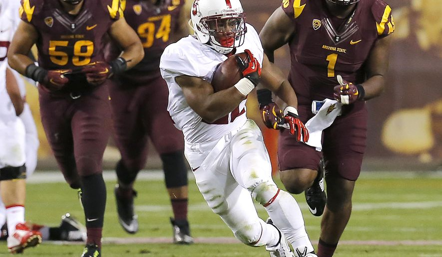 Stanford running back Remound Wright (22) runs for a first down against Arizona State during the second half of the NCAA college football game, Saturday, Oct. 18, 2014, in Tempe, Ariz. (AP Photo/Rick Scuteri)