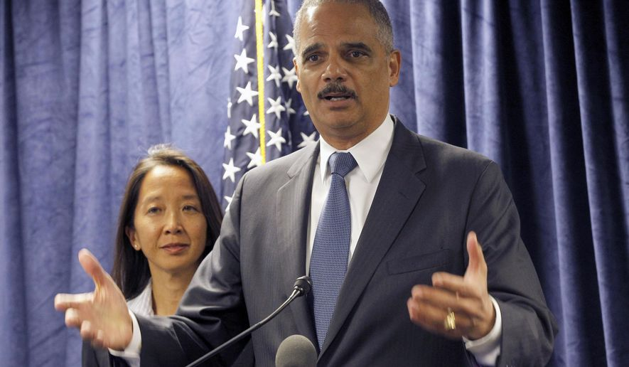 U.S. Attorney General Eric Holder, with Stephanie Yonekura Acting U.S. Attorney General talks during news conference in Los Angeles, Friday, Oct. 24, 2014. Holder spoke Friday at a graduation ceremony for an alternative sentencing program at a federal courthouse. (AP Photo/Nick Ut)