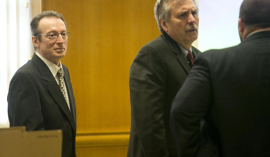 In this Monday, Oct. 20, 2014 photo, Joseph Reinwand, left, looks on as his public defenders David Dickman, center, and Troy Nielsen, right, talk before the first day of the Reinwand homicide trial at Wood County Courthouse in Wisconsin Rapids, Wisc. Jolynn Reinwand testified that she doesn't remember having a key to the home where prosecutors say her father, Joseph Reinwand, killed her ex-boyfriend. (AP Photo/The Marshfield News-Herald, Megan McCormick)
