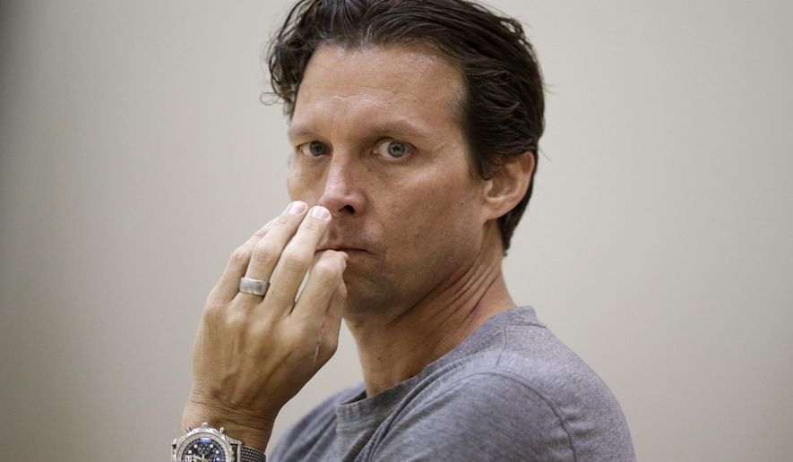 Utah Jazz coach Quin Snyder waits after practice Thursday, Oct. 23, 2014, in Salt Lake City. His presence in Utah adds to a distinct air of change around the league. With all the new coaches, big-name players with new addresses and other changes, this year's NBA looks more than a little different than the one that ended in San Antonio just four months ago. (AP Photo/Rick Bowmer)