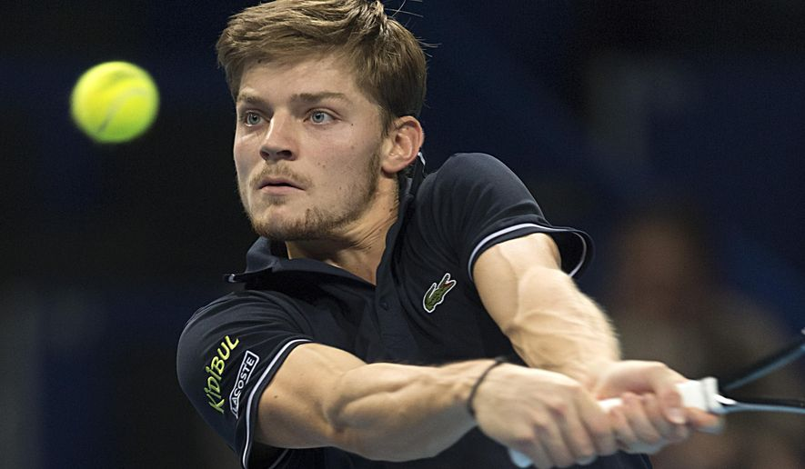 Belgium's David Goffin returns a ball to Canada's Milos Raonic during their quarter final match at the Swiss Indoors tennis tournament at the St. Jakobshalle in Basel, Switzerland, Friday, Oct. 24, 2014. (AP Photo/Keystone, Georgios Kefalas)
