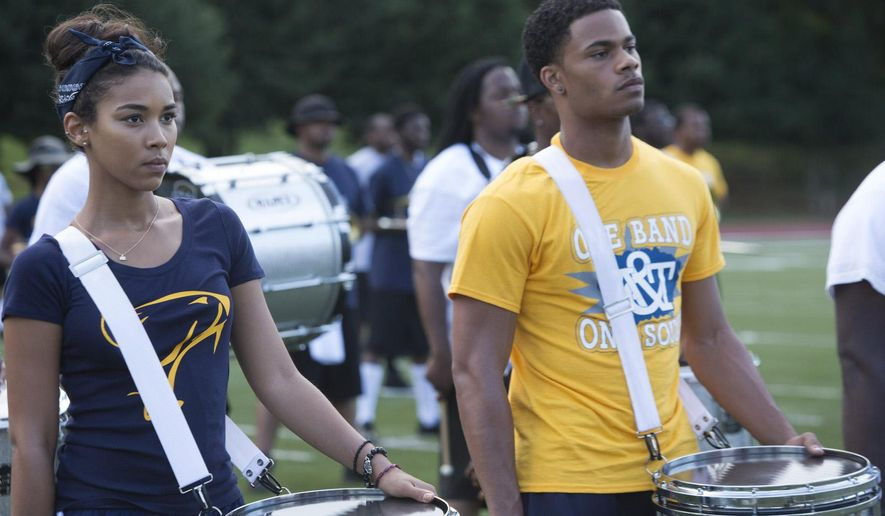 "This photo provided by VH1 shows, Alexandra Shipp, left, as Dani Bolton and Jordan Calloway as Jayven Lapierre, in ""Drumline: A New Beat,"" which airs at 9 p.m. EDT Monday, Oct. 27, 2014, on VH1. (AP Photo/VH1, Annette Brown)"