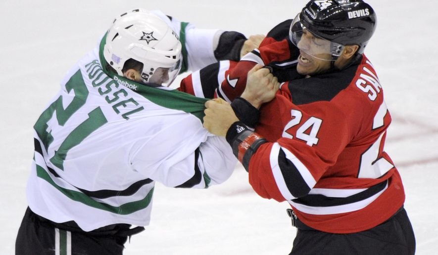 Dallas Stars' Antoine Roussel, left, of France, fights with New Jersey Devils' Bryce Salvadore during the second period of an NHL hockey game Friday, Oct. 24, 2014, in Newark, N.J. (AP Photo/Bill Kostroun)