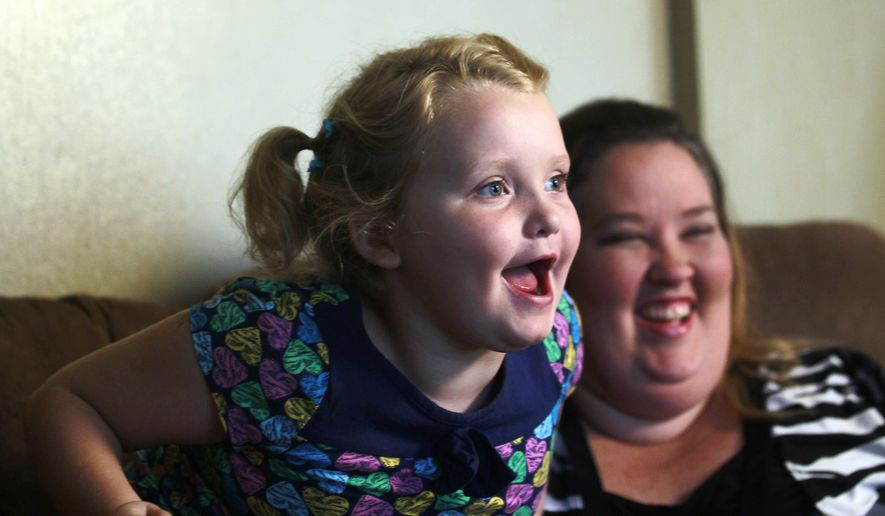 "Beauty pageant regular and reality show star Alana ""Honey Boo Boo"" Thompson speaks during an interview as her mother, June Shannon, looks on in her home in McIntyre, Ga. (Associated Press)"