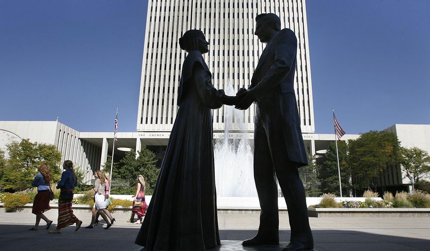 A statue of early Mormon leaders Joseph and Emma Smith outside the church office building of he Church of Jesus Christ of Latter-day Saints in Salt Lake City. (AP Photo/The Salt Lake Tribune, Scott Sommerdorf, File)
