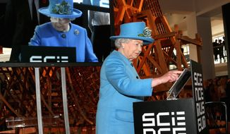 Britain's Queen Elizabeth II sends the first royal tweet under her own name to declare the opening of the new Information Age Galleries at the Science Museum, South Kensington, London, Friday Oct. 24, 2014. Normally a plaque is unveiled to herald the launch of a new project, but after touring the attraction dedicated to the history of communication and information the Queen touched a tablet screen to send her message to the world. (AP Photo/PA, Chris Jackson)  UNITED KINGDOM OUT  NO SALES  NO ARCHIVE