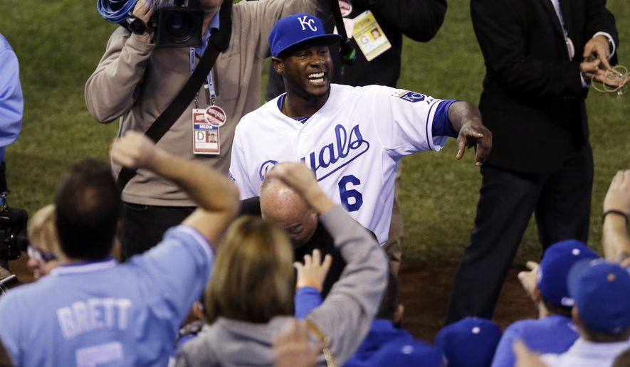 Kansas City Royals' Lorenzo Cain celebrates after  Game 2 of baseball's World Series against the San Francisco Giants Wednesday, Oct. 22, 2014, in Kansas City, Mo. The Royals won 7-2 to tie the series at 1-1. (AP Photo/Jeff Roberson)