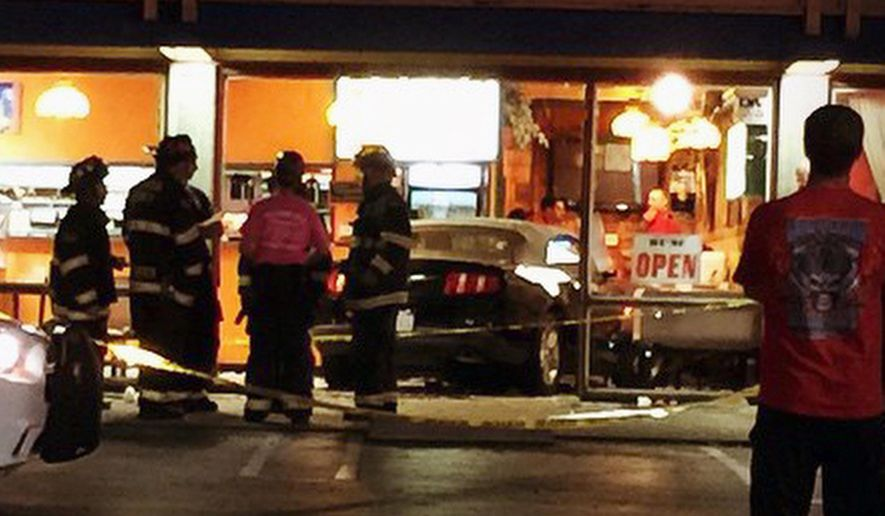 This Thursday, Oct. 23, 2014 photo provided by Leonard Rhone shows a car that plowed through a storefront in Dublin, Calif. Police say seven people were injured when a car crashed into the restaurant in a Northern California shopping center. A 56-year-old female driver had just pulled into a parking lot outside Taqueria Los Pericos in Dublin on Thursday night when she accidentally accelerated and plowed through the storefront. (AP Photo/Leonard Rhone)